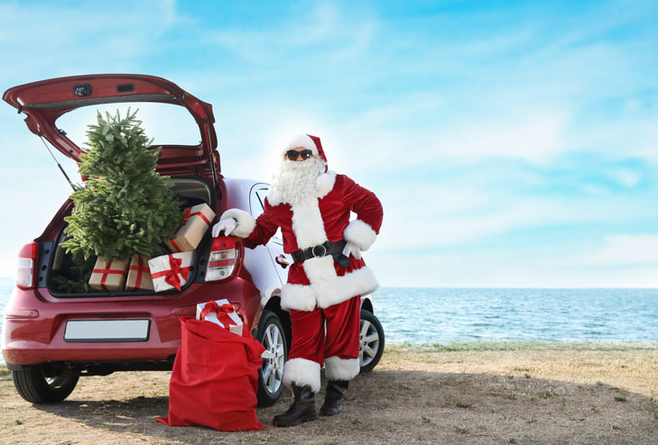 Santa with Christmas tree in car